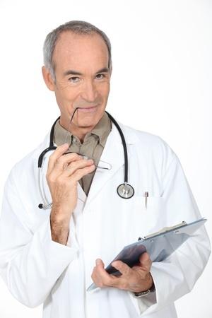 Doctor in lab coat smiling