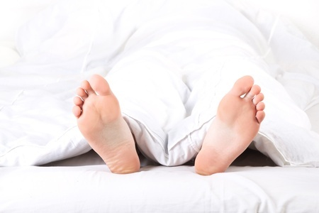 man feet in bed