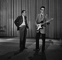 Buddy Holly smirking at Ed Sullivan