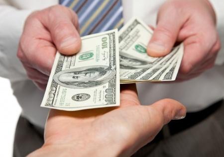 17666536 - human hands exchanging money - closeup shot