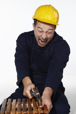 8605966 - man hitting his thumb with a hammer