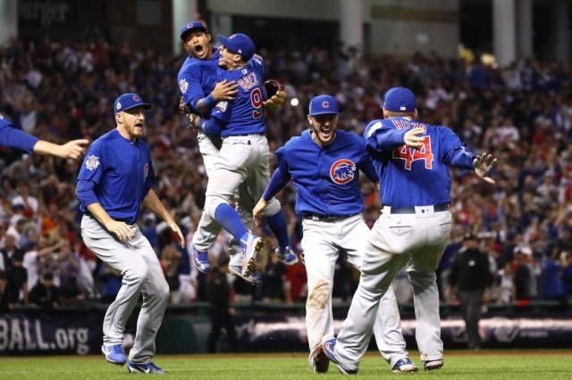 CLEVELAND, OH - NOVEMBER 02: The Chicago Cubs celebrate after winning 8-7 in Game Seven of the 2016 World Series at Progressive Field on November 2, 2016 in Cleveland, Ohio. (Photo by Ezra Shaw/Getty Images)