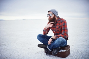 41785897 - beard lumbersexual hipster sitting on suitcase in deep thought